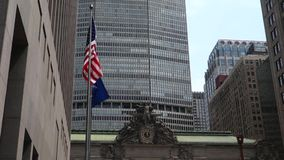 Grand Central Terminal in New York City. The facade of Grand Central Terminal, a railroad station in New York City. The flags of the United States of America and stock video footage