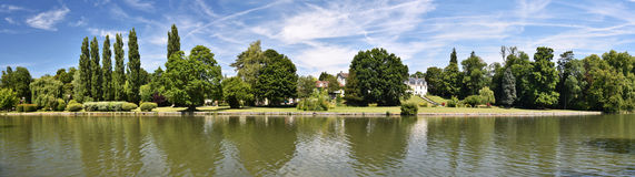 Grand Chanal panorama in Chantilly Castle parkGrand Chanal panor. Grand Chanal or Big Channel panorama seen from English Garden in Chantilly Castle Park, Oise Royalty Free Stock Photography