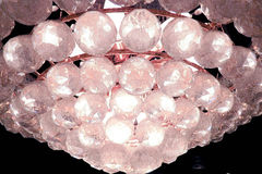 Grand chandelier with clear crystal balls Stock Images