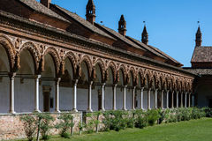 Grand Cloister of the Certosa di Pavia monastery, Italy. Grand Cloister of the Certosa di Pavia monastery, built in 1396-1495, features columns with precious Stock Photos
