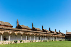 Grand Cloister of the Certosa di Pavia monastery, Italy. Grand Cloister of the Certosa di Pavia monastery, built in 1396-1495, features columns with precious Royalty Free Stock Photo