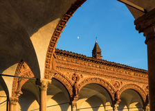Grand Cloister of the Pavia Carthusian monastery at sunset with Royalty Free Stock Image