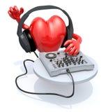 Grand coeur avec le casque du DJ devant le consolle Photos libres de droits