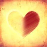 Grand coeur rayé par des moitiés sur le vieux papier beige Photographie stock libre de droits