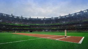 Grand cricket stadium with wooden wickets diagonal view in daylight stock photo