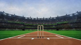 Grand cricket stadium with wooden wickets front view in daylight royalty free stock photos