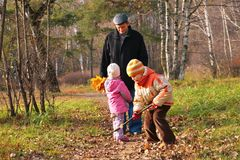 Grand-dad with grandsons in forest Royalty Free Stock Photo