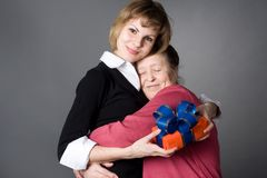 Grand daughter and  grandmother embrace each other Royalty Free Stock Photo