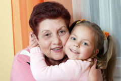 Grand daughter and grandmother smiling Stock Photo