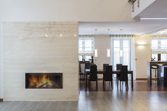 Grand design - Fireplace and dining room Royalty Free Stock Images