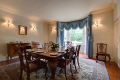 Grand Dining. Room with table set for dinner in opulent traditional English home Royalty Free Stock Photography