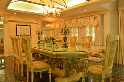 Grand Dinning Room. A Dinning room from a nicely decorated house Royalty Free Stock Photo