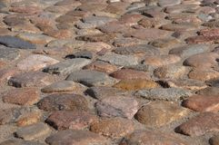 Grand dos de pavé rond de granit Photographie stock