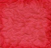 Grand dos rouge chiffonné de papier de soie de soie Photographie stock libre de droits