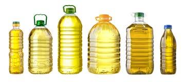 Grand en plastique d'huile de bouteille sur le fond blanc Image stock