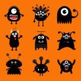 Grand ensemble de monstre noir Caractère effrayant de silhouette de bande dessinée mignonne Collection de bébé Fond orange D'isol Image libre de droits