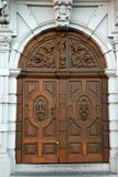 Grand entrance. Old and heavy wooden entrance door Stock Photography