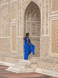 Grand Entrance. India woman in blue salwar kameez entering the doorway into the ornate white marble Mughal tomb (I'timad-ud-Daulah) in Agra, Uttar Pradesh, India Royalty Free Stock Photo
