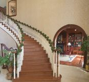 Grand Entry And Library. Entry to luxury home with library visible Stock Photo