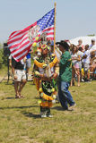 The Grand Entry at the NYC Pow Wow. NEW YORK - JUNE 8, 2014: The Grand Entry at the NYC Pow Wow in Brooklyn. A pow-wow is a gathering and Heritage Celebration of stock image