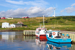 Grand Etang on the Capbot Trail in Cape Breton,. Grand Etang, Canada – August 6, 2015:  Picturesque rural scene with water and windmill on hillside, in Grand Stock Images