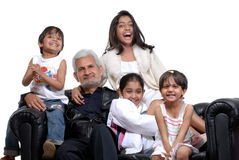 Grand father with four children. Cheerful grand children with grand father royalty free stock photos