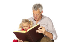 Grand-father read to his grand-child. Grand-father is reading to his grand-child isolated over white background stock photos