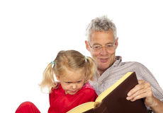 Grand-father read to his grand-child. Grand-father is reading to his grand-child isolated over white background stock image