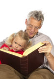 Grand-father read to his grand-child. Grand-father is reading to his grand-child isolated over white background stock images