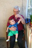 Grand father and son playing Stock Photo