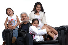 Grand father with three children. Grand children with grand father stock photos