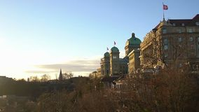Grand Federal Palace of Swiss Parliament in Bern, Switzerland flags flapping. Stock footage stock video