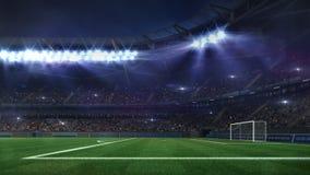 Grand football stadium illuminated by spotlights and empty green grass royalty free stock image