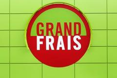 Grand Frais supermarket logo on a wall. Ferney, France - October 1, 2017: Grand Frais supermarket logo on a wall. Grand Frais is a French supermarket brand stock photography