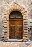Grand front door in Volterra, Italy. stock image