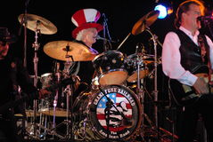 Grand funk railroad. On stage singing and playing guitar drummer main stage stock images