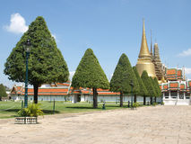 Grand Golden Palace Grounds. Grounds and Tree Lined Path of to a Golden Thai Palace in Bangkok Stock Photos