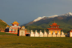 Grand and gorgeous new Gerisi Temple on Tibetan Plateau, with snow mountains on the background Stock Photography