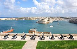 Grand Harbor Valletta. Scenic view of Grand harbor viewed from Upper Barrakka Gardens over saluting battery of canons, Valletta, Malta Stock Photos