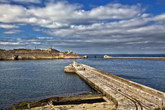 Grand Harbour Breakwater. The entrance to one of the most beautiful harbours in the world. The Grand Harbour in Malta. Here as seen from Fort Ricasoli in Kalkara Royalty Free Stock Photography