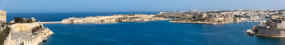 Grand Harbour Pano. A view of the Grand Harbour in Malta, as seen from Upper Barrakka Gardens.  Left to Right: Lower Barrakka Gardens, harbour entrance Stock Photography