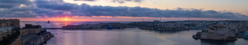 Grand Harbour panorama at colorful sunrise, Valletta, Malta. EU Royalty Free Stock Images