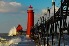 Grand Haven Lighthouse with Big Waves. In Michigan Royalty Free Stock Photo