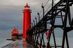 Grand Haven Lighthouse at Sunrise. Grand Haven Lighthouse in Michigan at sunrise Royalty Free Stock Photo