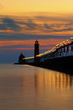 Grand Haven Pier at Night - Michigan, USA. Close up view of the Grand Haven Michigan Pier at night. Lights on the catwalks sparkle like diamonds as the sun sets Royalty Free Stock Photography