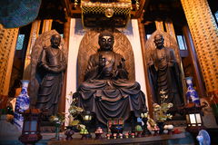 Grand Hero Hall in Yongfu Temple Hangzhou. Divine Buddha statues in the temple stand tall Stock Photos