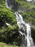 Grand Himalayan Waterfall Causes Mist in a Forest Royalty Free Stock Photos