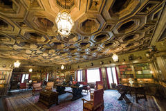 Grand historical study room with library. California, USA, 09 Jun 2013: Grand study room with attached library at Hearst Castle, which is a National and Royalty Free Stock Photo