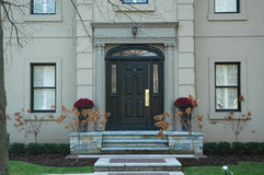 Grand Home Entrance. With black door royalty free stock photography