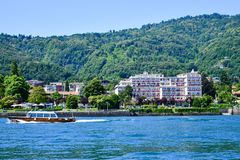 Hotel in Stresa on Maggiore Lake,  Italy. Grand Hotel  Grand Hotel des Iles Borromees.in Stresa. View from the Maggiore Lake  Ernest Hemingway visited the town Royalty Free Stock Images